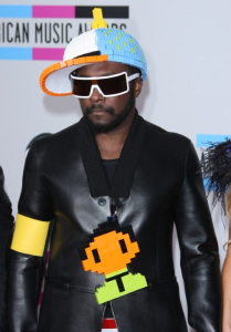 Will.I.Am in a lego baseball cap