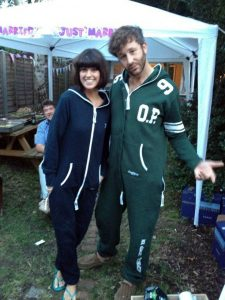 Chris ODowd and Dawn Porter wearing matching onesies 1324220 225x300 The Onesie Story: A Growing Success